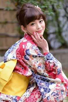 She is wearing a yukata. Yukata is kimono of summer.