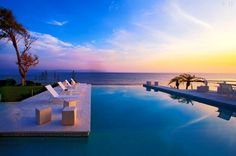 Located in beautiful Puerto Vallarta, Mexico, Casa China Blanca, with its modern and sleek design, overlooks the Pacific Ocean's Banderas Bay. With nearly completely white interiors, paired with luxurious pink marble floors – the resort villa exudes rest and relaxation. The large winding balconies boast a spectacular view, particularly during sundown | Home Adore