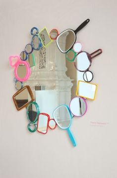 Recycled mirrors ~ Would be cute in a kids room and if they were all the same colors or all bright colors or all neutral colors