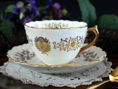 Coalport Teacup and Saucer, White and Gold Cameo Design, English Tea Cup, Fine Bone China. Scalloped rims and gilt twig and scroll work over a white base. Great vintage condition no chips, cracks or c Tea Cup Set, Tea Cup Saucer, Tea Sets, Vintage Dishes, Vintage Tea, English Tea Cups, Teapots And Cups, Teacups, English China