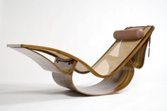 Rio chaise lounge by Oscar Niemeyer now that is just hot! i dont even know if i would get on it lol but i like it!