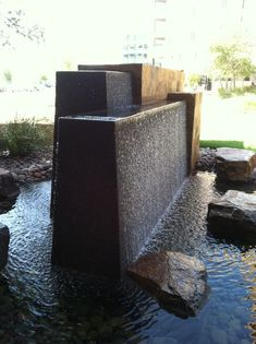 Garden water features are of course water features for your garden and this means things like waterfalls and fountains that … Water Fountain Design, Modern Fountain, Fountain Ideas, Landscape Elements, Landscape Design, Garden Design, Modern Water Feature, Backyard Water Feature, Landscaping With Fountains