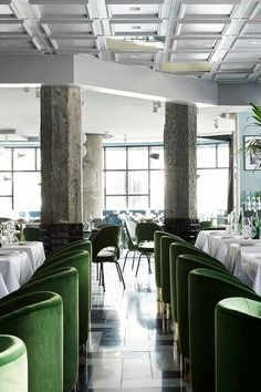Restaurant Dining Chairs | Stunning green velvet dining chairs that completely steal the show! | San George in Amsterdam | Restaurant Interior #restaurantinterior #restaurantinteriors