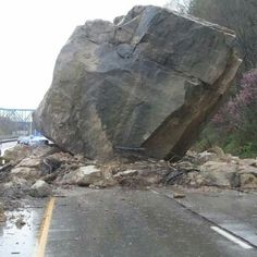 This is a boulder. It fell. Big as a house? No! Two houses.  Near Ashland, KY, Hwy 52. 041115