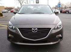 "New 2014 Mazda Mazda3 i Touring. ""Titanium Flash"" color."