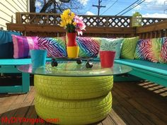 Cool DIY Backyard Furniture! | MY DIY ANGELS, DIY and Extreme Couponers - THE COFFEE TABLE MADE FROM OLD TIRES AND SPRAY PAINTED IS FANTASTIC.  I ALSO LOVE THE COLOURFUL ANIMAL PRINT CUSHIONS.