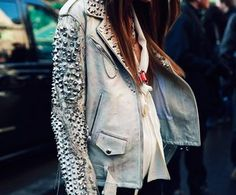 I need to do this now that I have a faux white leather jacket!!'