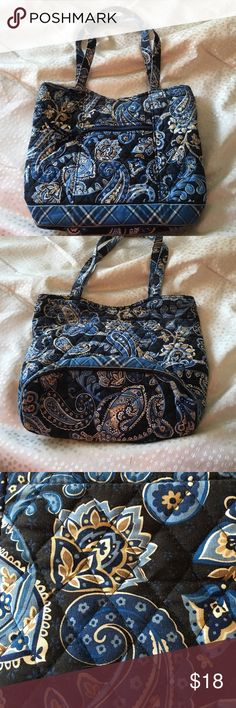 """Vera Bradley Bucket Tote, Navy Blue Print Vera Bradley Bucket Tote, Navy Blue Print. Previously Loved, but still in good condition! Zipper front pocket, magnetic top closure, pockets inside. Retired Bag! Shows a little wear at the top. 10"""" deep/ long and 12.5"""" wide across. Vera Bradley Bags Totes"""