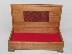 """Finely Crafted Handmade Cherry Jewelry Box with Red Cedar and Butternut Checker Board Laminate Inlay. Finely Crafted Handmade Cherry Jewelry Box with Red Cedar and Butternut Checker Board Laminate Inlay """"Checkmate"""" Is handcrafted and constructed from Cherry with Red Cedar and Butternut laminate inlay and accent's. I am the Adirondack Woodworker and I design my one-of-a-kind hardwood creations in my Adirondack New York woodshop using woods mostly harvested from my own property. Most pieces..."""