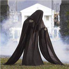 Spooky and Kooky Halloween Decorations :: The Life-sized Cloaked Grim Reaper from Frontgate is scary even before you see the face ...