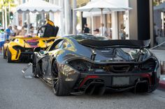 A kind of insane combo. Fully exposed carbon McLaren P1 and Chassis #001 McLaren P1GTR [OC][5731x3826] - see http://www.classybro.com/ for more!