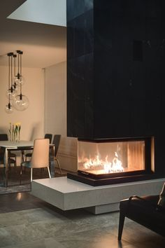Spacious Home with a Warm Interior in Kiev - Design Milk Home Fireplace, Modern Fireplace, Fireplace Surrounds, 3 Sided Fireplace, Black Fireplace, Interior Design Living Room, Living Room Designs, Contemporary Fireplace Designs, Interior Architecture