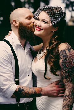 Love the dress, hair style, veil, and evvvvverrrry thing...Danielle & Rob's pin-up style-meets-comic books wedding....