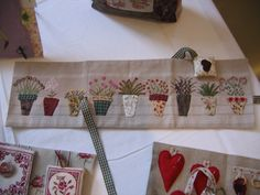 * Pique-aiguilles*  -  Pretty use of fabric and embroidery by willowberrydesigns.