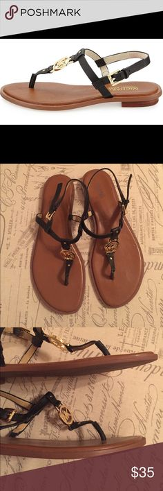 Michael Kors t-strap sandal Black leather with gold detailing and accents. Adjustable buckle. Very cute for summer! MICHAEL Michael Kors Shoes Sandals