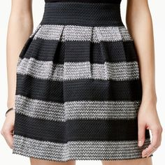 Freestyle Metallic Skirt with tags Size extra small, but it has an elastic waist so I am sure it can fit a small. It has never been worn and the tags are still on it. Very cute metallic stripe pattern. Urban Outfitters Skirts A-Line or Full