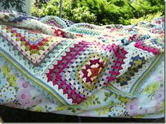 Big granny squares blanket, scrapghan.  This blanket reminds me of potted geraniums, white wooden porch rockers, fireworks, and a white-hot s...