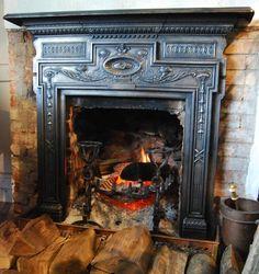 A polished cast iron fire surround,
