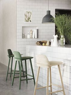 white tiles and green stools - could use the niche in the wall for cook books