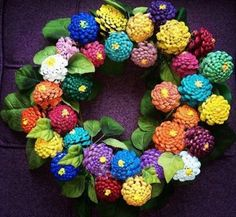 Learn how to make a beautiful colourful Pine Cone Zinnia Wreath using a simple Coat Hanger. Try out the gorgeous Pine Cone Zinnia Flowers too, they'll look amazing decorating your place.