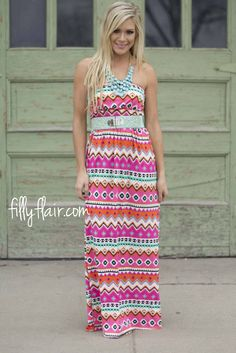 """Printed maxi for Spring - This adorable strapless printed maxi dress with elastic top and waist band in fuchsia is the perfect addition to your wardrobe! Belt sold separately   Bust in Small 24"""" Medium 26"""" Large 28"""" Waist in Small 22"""" Medium 24"""" Large 26"""" Length in Small 48"""" Medium 49"""" Large 50"""" 95% Polyester 5% Spandex Lining: 100% Polyester Hand Wash Cold Made in U.S.A. Model is size 4 in a small. Small 0/4, Medium 6/8, Large 10/12"""
