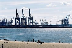 "HAMBURG Elbstrand - I love just sitting there and looking at the harbor with all the ships passing by, the cranes and docks... (""Elbe"" by schorlemädchen, via Flickr)"