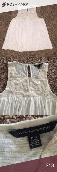 AE CREAM TANK TOP!!! American Eagle cream tank top! Very comfy and flowy! It has a detailed design across the chest and a small opening in the back. . Asking $18/OBO! Feel free to message me with questions and offers! I consider all offers :) American Eagle Outfitters Tops Tank Tops