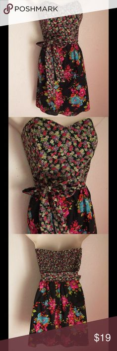 Gorgeous Floral Dress Really pretty floral pattern. Sash ties around waist. Strapless design. Vibrant colors. Dresses