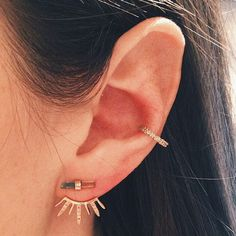 30 Extreme Piercings That Put Single Studs To Shame #refinery29 http://www.refinery29.com/extreme-piercing#slide11 A delicate ear jacket and diamond hoop are a dynamic duo.
