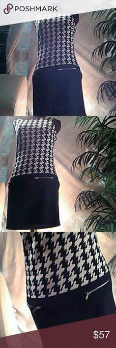 👗💋Black & White Checkered Pattern top Mini Dress Mini dress Black and white checkered pattern at top...   solid black on the bottom of the Mini)knee length dress with zippers on but sides Cynthia Rowley Dresses Midi