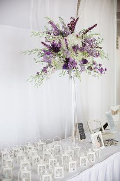 Tall Wedding Reception Decor Centerpieces with Lanterns Purple and White Wedding Flowers | Clearwater Beach Wedding Florist Iza