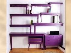 Re-purpose old tables and desks as a bookshelf wall in the office!!!  Love the visual interest...  I'd select a color other than purple though.