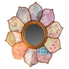 """Wall mirror with petal collage frame.  Product: MirrorConstruction Material: Mirrored glass and metalColor: MultiFeatures: Floral patternDimensions: 27"""" Diameter"""