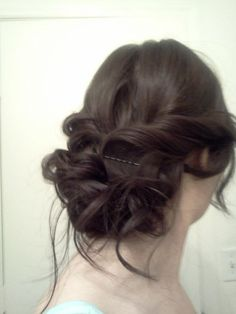 Soft, wavy updo. I was inspired by the Katniss Everdeen one.