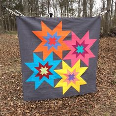 "Judy Martin's Star Cluster block made quilt sized and with the addition of Rising Stars: Confessions of a Fabric Addict: Stunning Stars Quilt - ""Exploding Stars""! Big Block Quilts, Star Quilt Blocks, Lap Quilts, Farm Quilt, Jelly Roll Quilt Patterns, Star Quilt Patterns, Quilting Tutorials, Quilting Projects, Modern Quilting Designs"