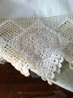 Beautiful vintage crocheted edging on linen sheet