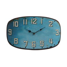 You won't have a blue moment with this beauty on your wall. Modern and vintage-inspired all at once, the oblong face with aged turquoise finish complements just about any style, from eclectic urban loft to cozy railroad apartment.