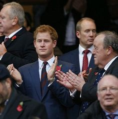 Prince Harry attends the Autumn international rugby union Test match between England and New Zealand at Twickenham Stadium, southwest of London on Prince Harry attends the Autumn international rugby union Test match between England and New Zealand at Twickenham Stadium, southwest of London on Nov. 8, 2014.