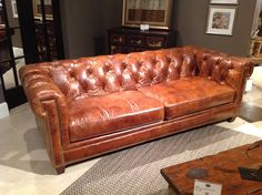 Beautiful leather tufted sofa from Bradington Young.