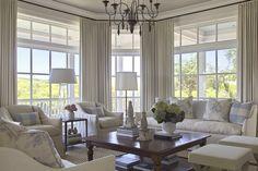 Urban Grace Interiors fabulous beach house living room with transom windows