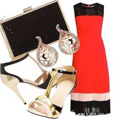 Questo bellissimo vestito a blocchi di colore è perfetto per una serata elegante. Impreziosito dai sandali e dalla clutch oro e nero e dagli orecchini raffinatissimi.