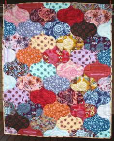 Rock the Casbah.  Curlicue Crush Quilt by Rebecca Johnson, featured on her blog. Pattern in her shop, but if you subscribe to Fat Quarterly by February 28th, you can get the pattern for free.