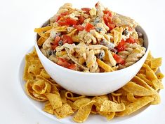Fiesta Ranch Chicken Pasta Salad is full of fresh southwestern flavors with black beans, corn, cheese and tomatoes. Hearty salad recipe topped with Fritos!