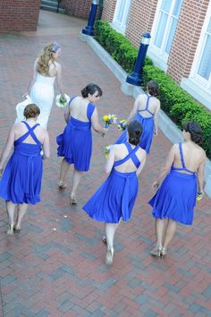 Blue bridemaids dressed. From Paul & Amy's Simple, Blue & Yellow Frederick Maryland Wedding at The Faux School. Images by Rachel Harrod Photography.