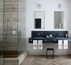RESIDENTIAL | Jenny Wolf Interiors  floating soapstone vanity + wall mounted fixtures + herringbone floor.  Dang that's good design.