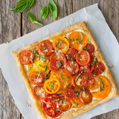 Fresh tomatoes get baked in a flaky puff pastry shell with goat cheese and caramelized onions.