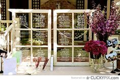 white writing on old windowpanes. could even inspire centrepieces to reflect light and not block anything out