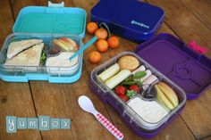 Yumbox lunches with smoked turkey, cheese, baby tomatoes, crackers, apple slices and greek yogurt with caramelized apples.