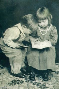 This photo taken in the 1910's, shows two Edwardian era children, trying to share the same book and having a discussion.  A very tender scene of American children. | eBay