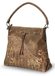 I love this Ariat western handbag tote! Hues of pink, mauve, and green create elegant Country Rose floral embroidery design. Braided leather...